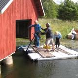 Muddring vid båthus