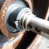 Detta är den kreamiska tätningen mellan axel och pumphjul.